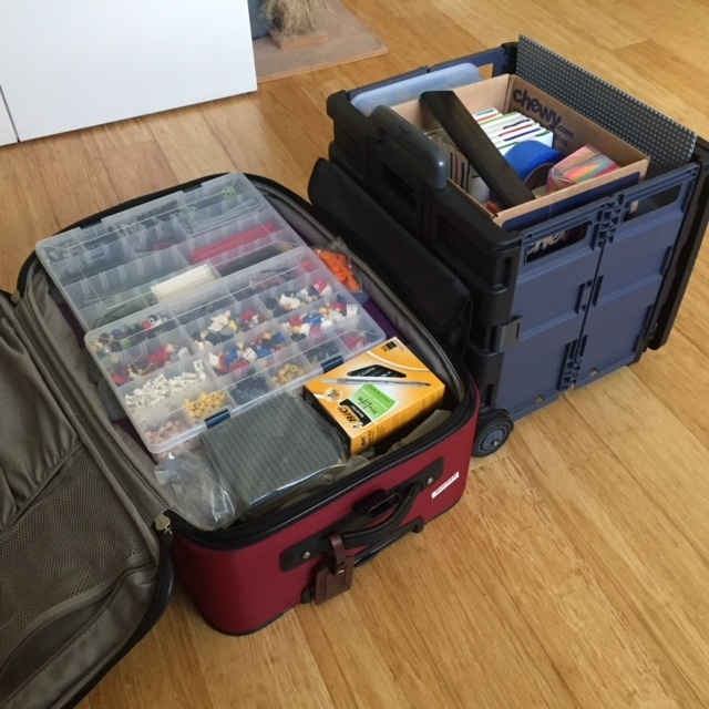 Packing up LEGO® - they take up a whole suitcase and a wheelie cart!