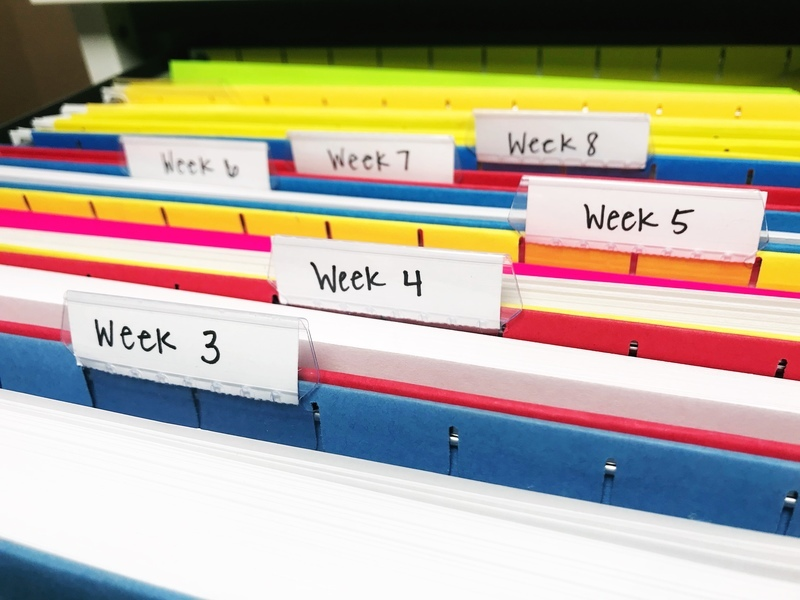 Organizing all those papers into weekly file folders!