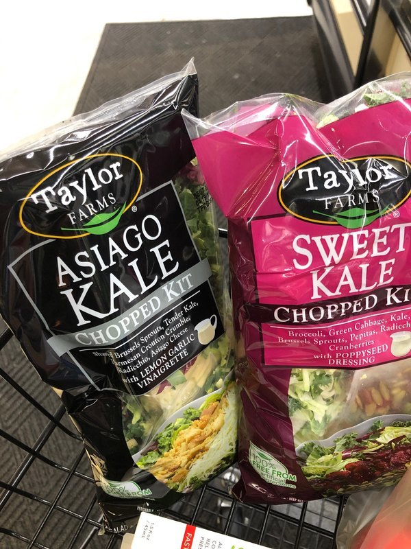 Photo of packages of Taylor Farms Asiago Kale and Sweet Kale taken by Beth Greer's client during her shopping trip. Are these healthy to eat?