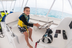 Timmy on a boat in grand cayman
